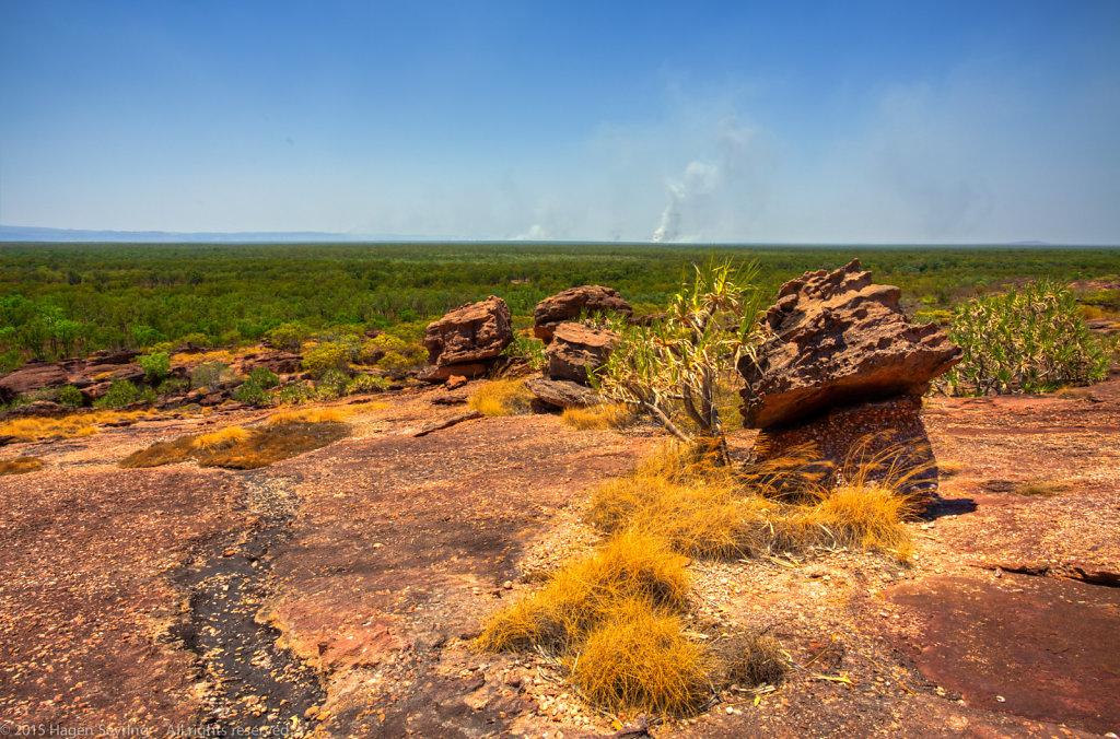 View to the Nourlangie rocks from  Nawurlandja across the bush with bushfire